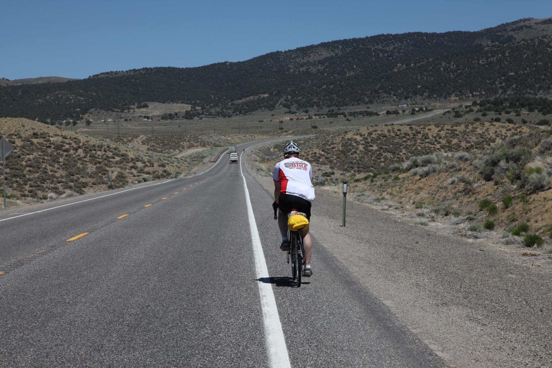 Bicyclist riding on U.S. 50 in Nevada