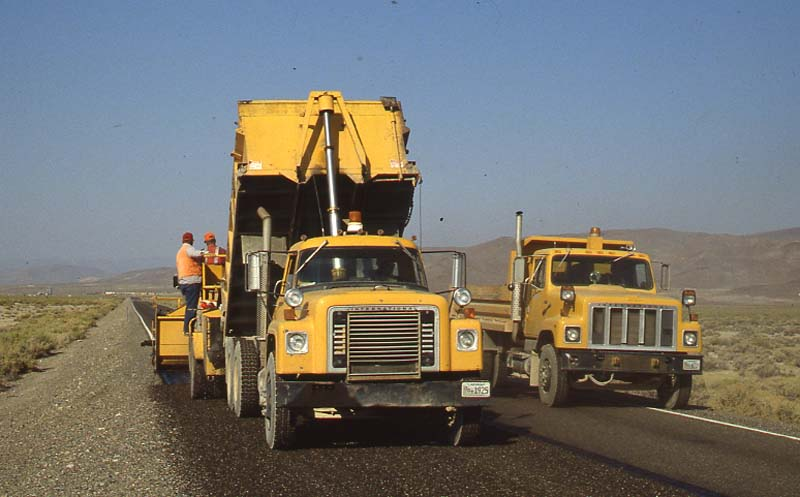 NDOT trucks and workers pave U.S. 50 in rural Nevada.