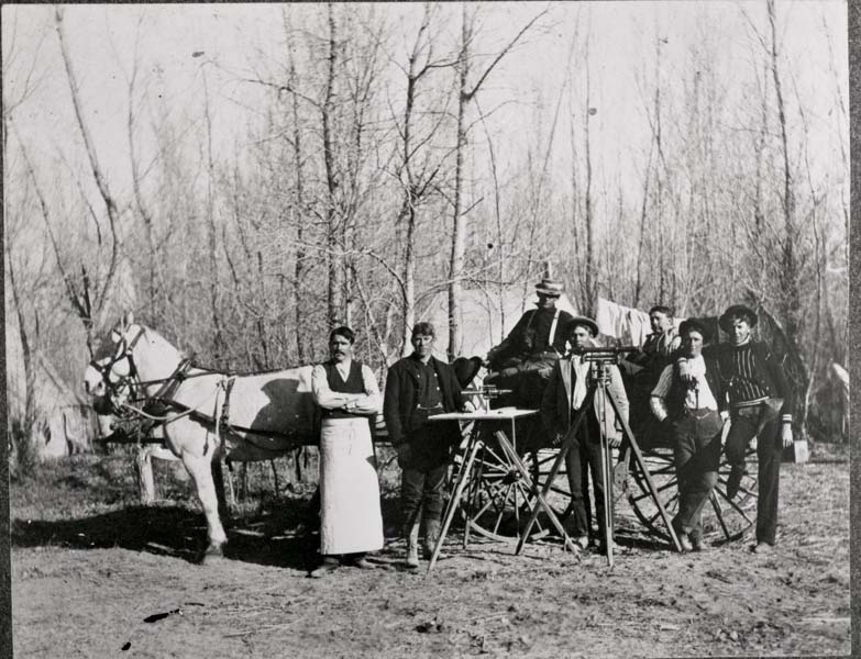 Very early survey team with cook