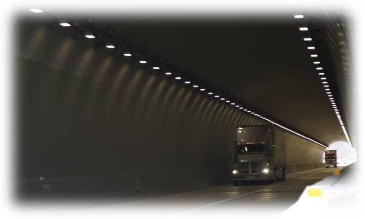 A photo of a truck driving through a tunnel