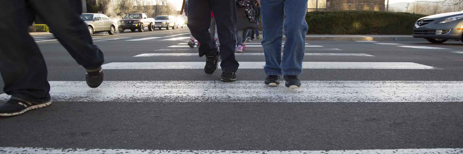 Pedestrians crossing the street at a designated crosswalk