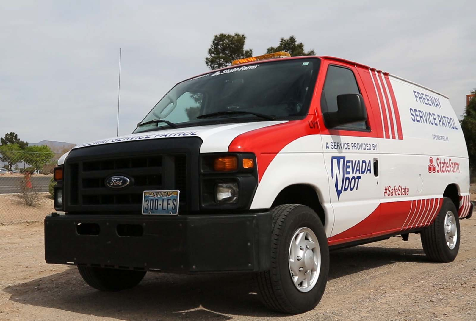 A photo of the Freeway Service Patrol Van, sponsored by State Farm