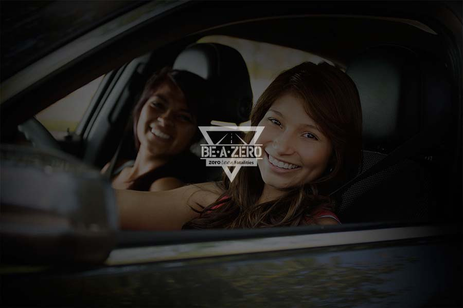 A photo of a smiling female driver and her passenger