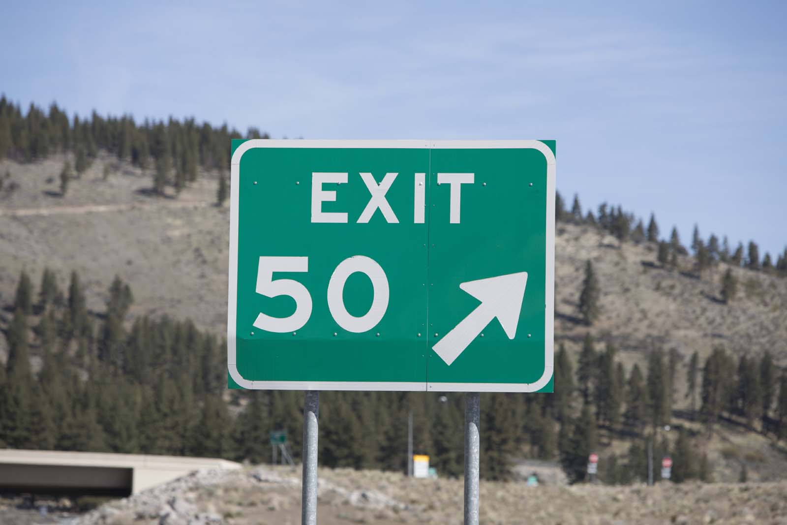 A green freeway exit sign on I-580 for exit 50.